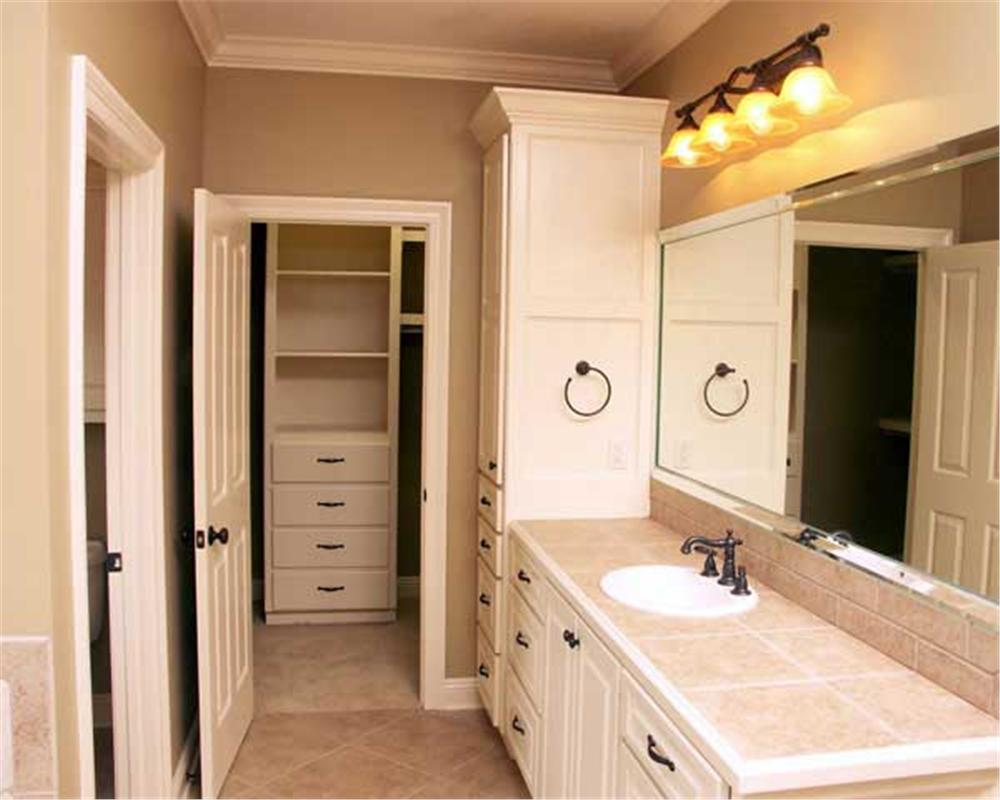 Master bath of Country style home showing walk-in closet straight ahead