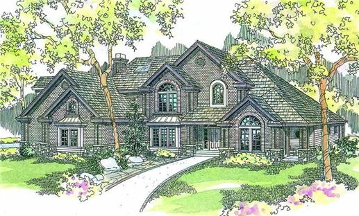 English Manor-style home that depicts a delightful mix of brick-stone exteriors, steep gables, and arched windows