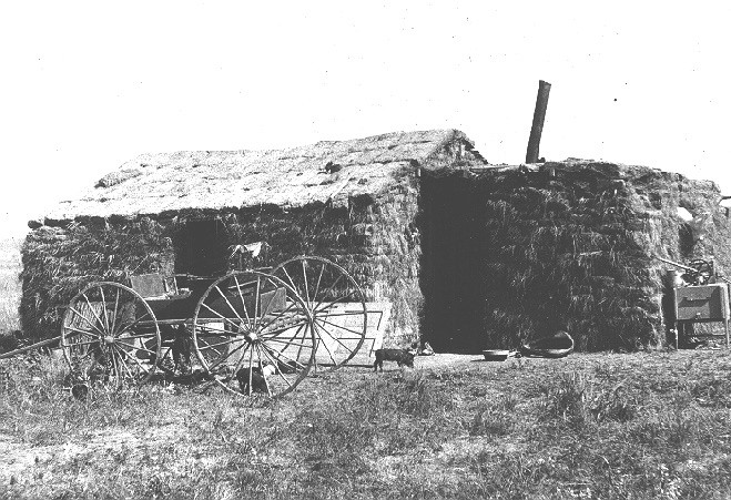 Sod house with two rooms on the American prairie, circa 1901