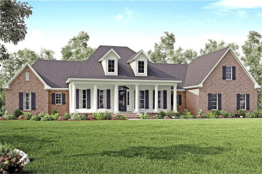 Traditional style home with brick siding, large porch columns, and twin dormers