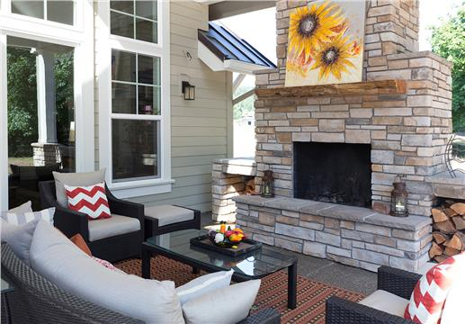 This covered rear porch with fireplace is perfect for family gatherings in the evening or entertaining friends.