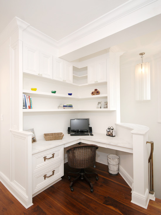 Stunning white built-in desk area at the top of the stairs