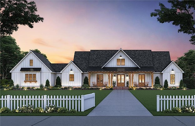Charming white Farmhouse with vertical siding and impressive covered porch with natural timber accents