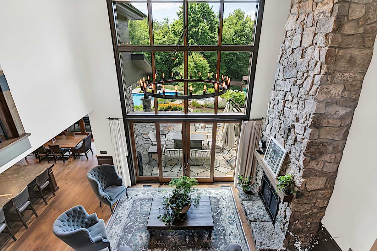 Two-story-tall Great Room with double-height windows and balcony