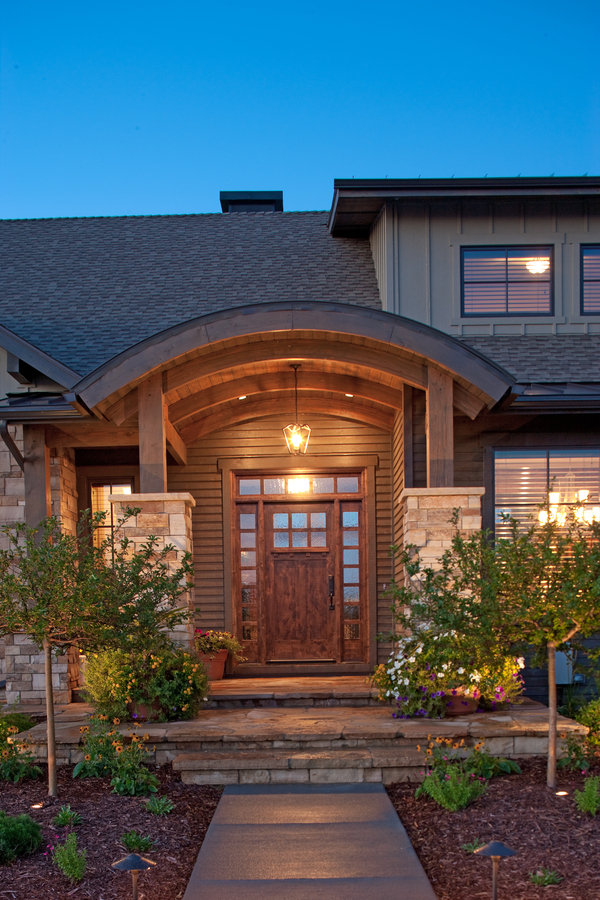 large front door made of hardwood with curved front porch