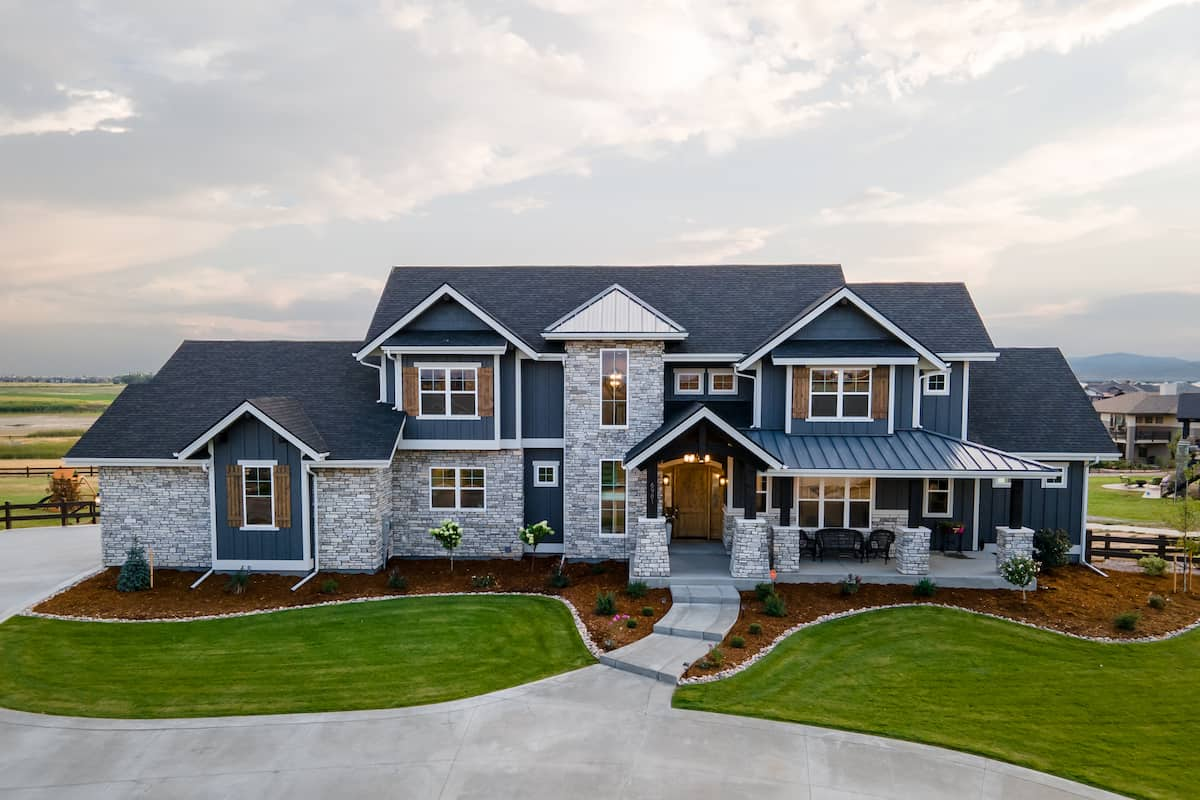 Two-story Traditional style home with Contemporary style touches and blue accents