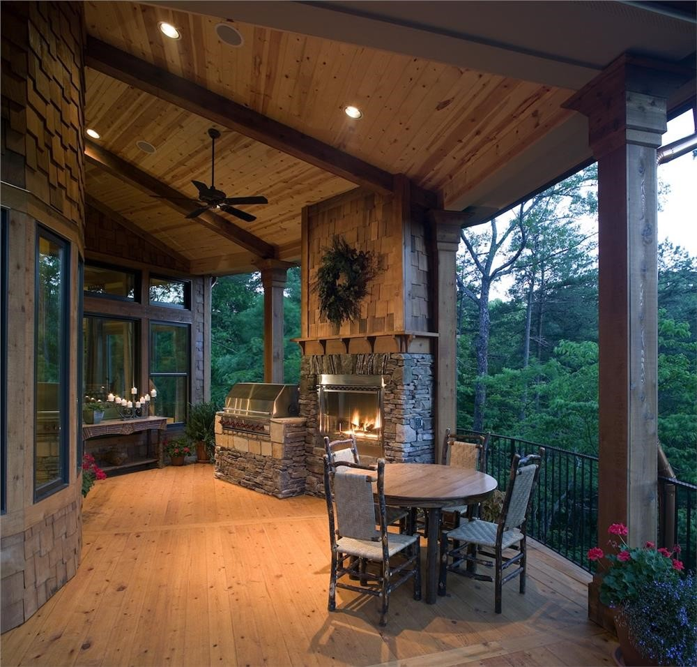 Covered rear porch with fireplace and dining area