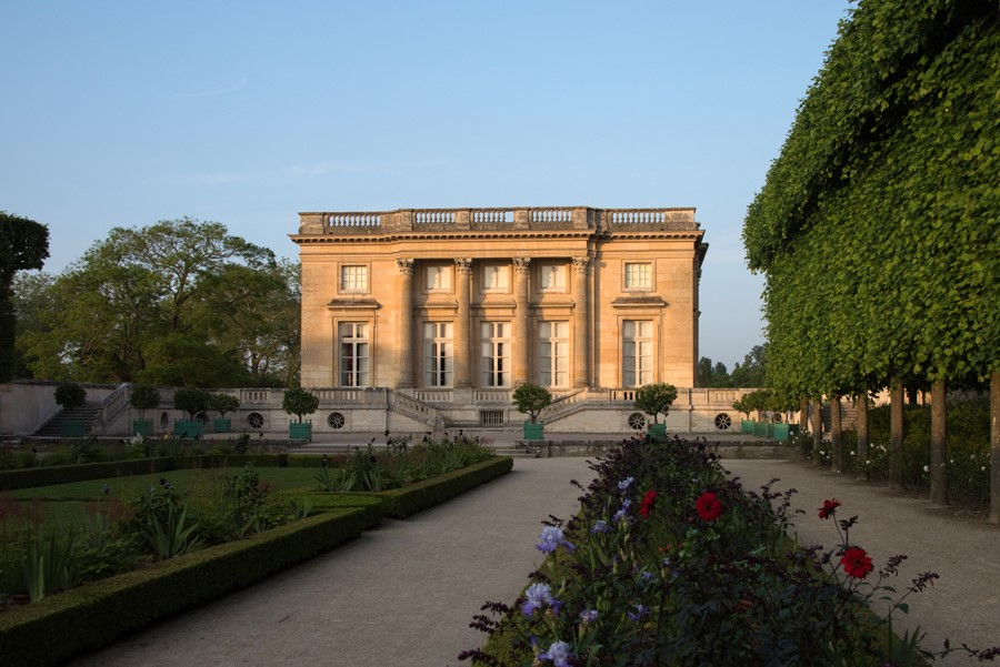 Le Petit Trianon  a small chateau in the gardens of Versailles