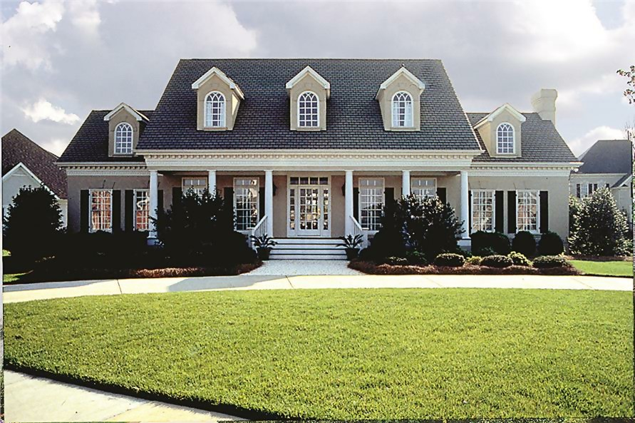 Stucco-sided Colonial home with covered front porch narrow white columns