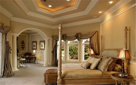 Master bedroom that has the passage to the sitting room adorned by round columns