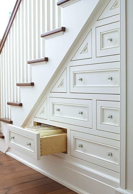Custom-built under-stairs storage drawers