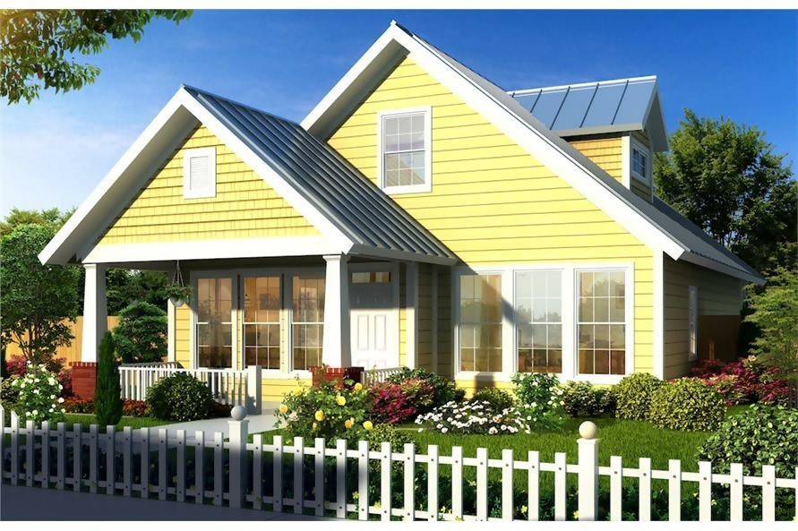 Yellow bungalow style home with front porch and metal roof