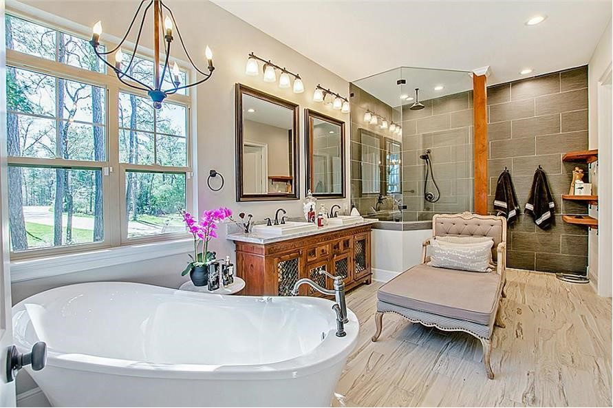 Large, relaxing bathroom with freestanding tub and chaise