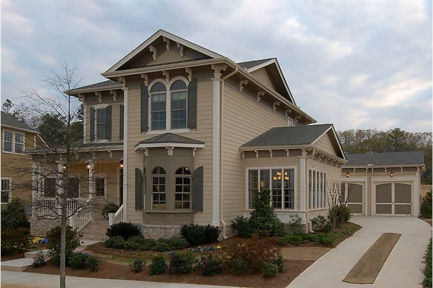 Victorian classic with gable roof, corbels, arched windows, and decorative shutters