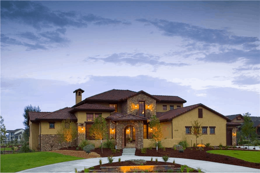 Tuscan style home with ochre-colored stucco  siding and stone accents