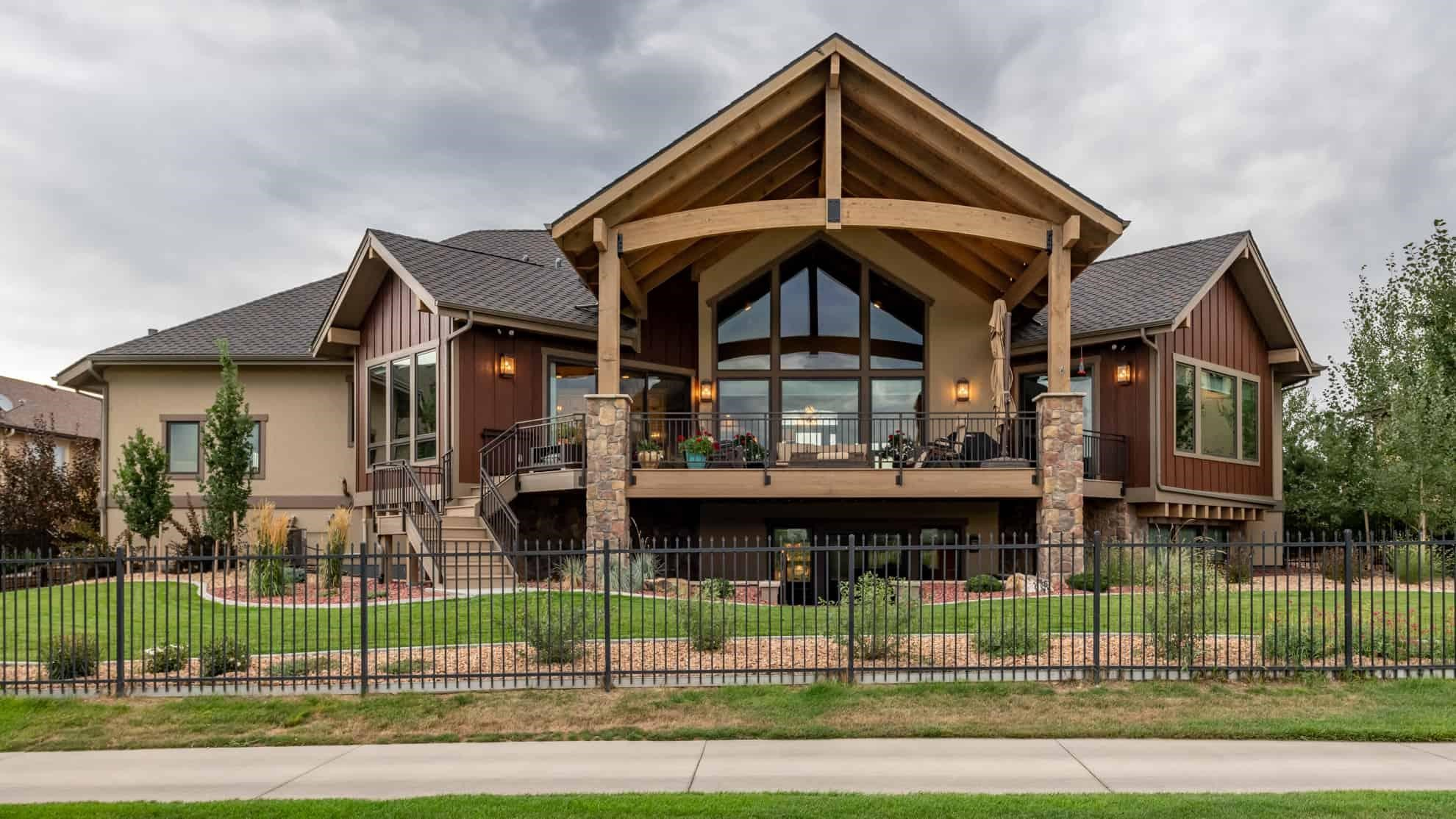 Rear of a single-story Ranch home showing the rustic influence on its design
