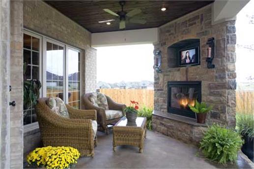 Rear porch with fireplace and homey furniture