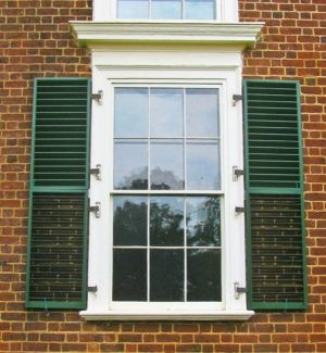 Close up of Monticello's green shutters against brick background