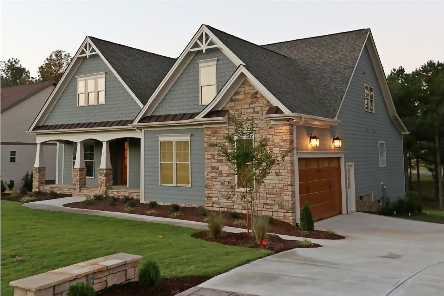 Transitional Craftsman style home with stone  and timber accents
