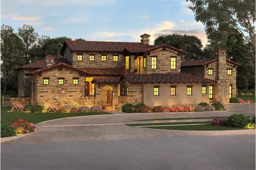 Southwest style home with brown tile roof and stone exterior