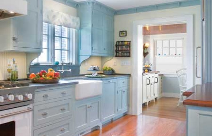 Smaller kitchen that appears larger because of light color and large window