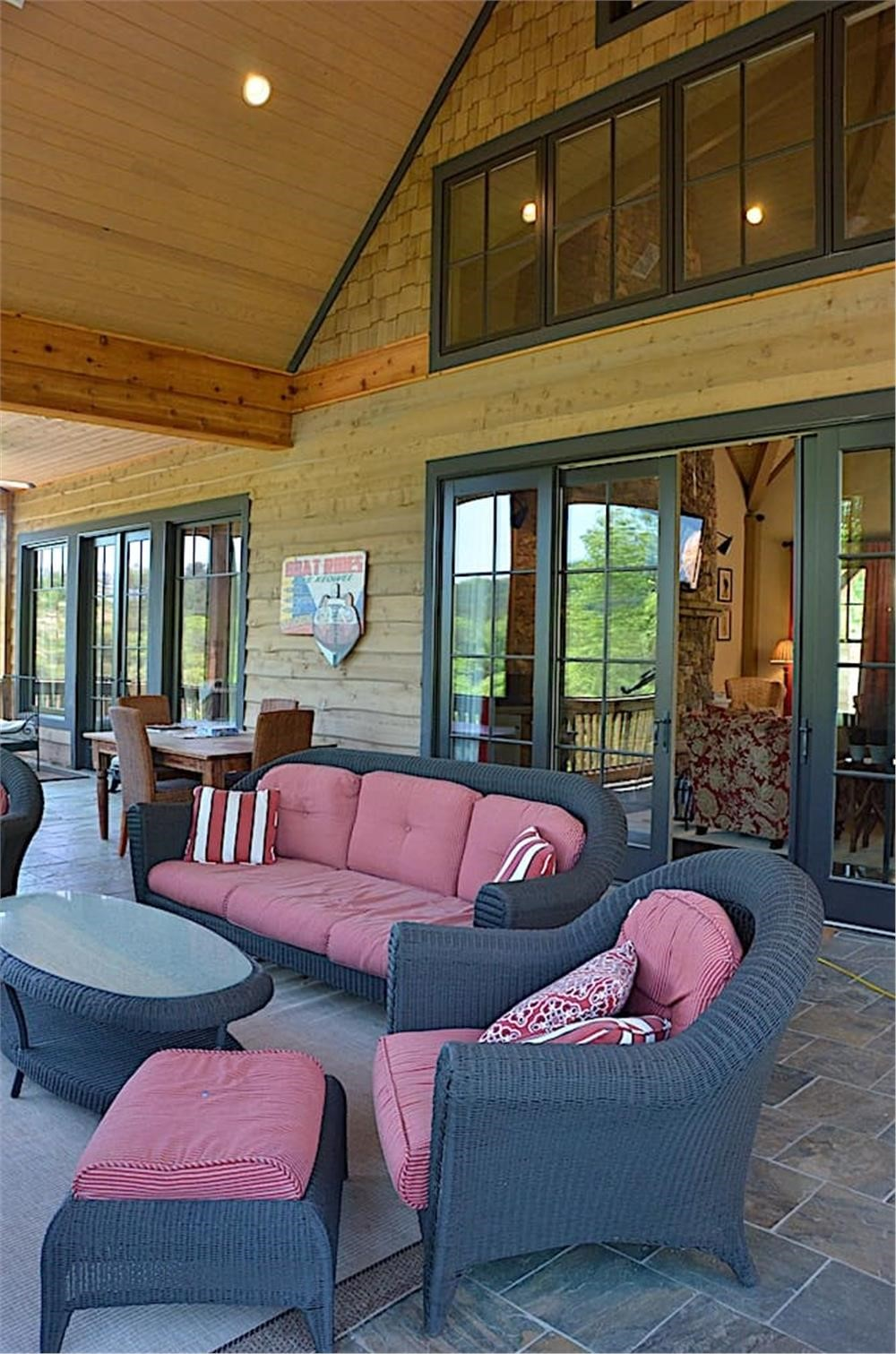 Covered rear porch with outdoor furniture vaulted ceiling