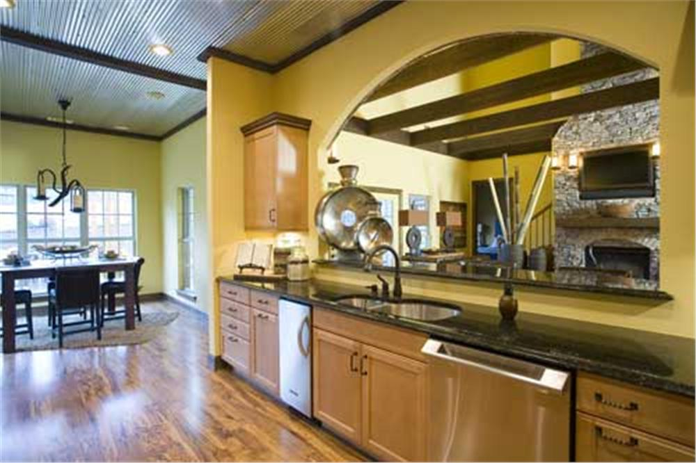 Open concept kitchen with arch opening up to the great room.