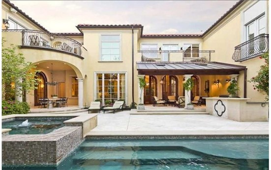 Open courtyard with a swimming pool in 2-story Tuscan style home