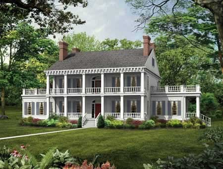 White Plantation style home with 2-story columns, a wide front porch, a balcony above, and two side balconies