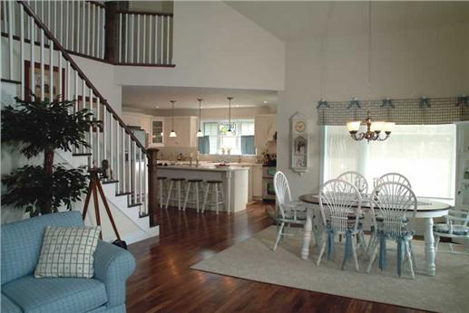 Kitchen, dining, and family areas in an open floor plan