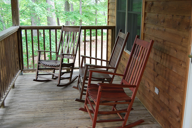 Rustic front porch with rocking chairs