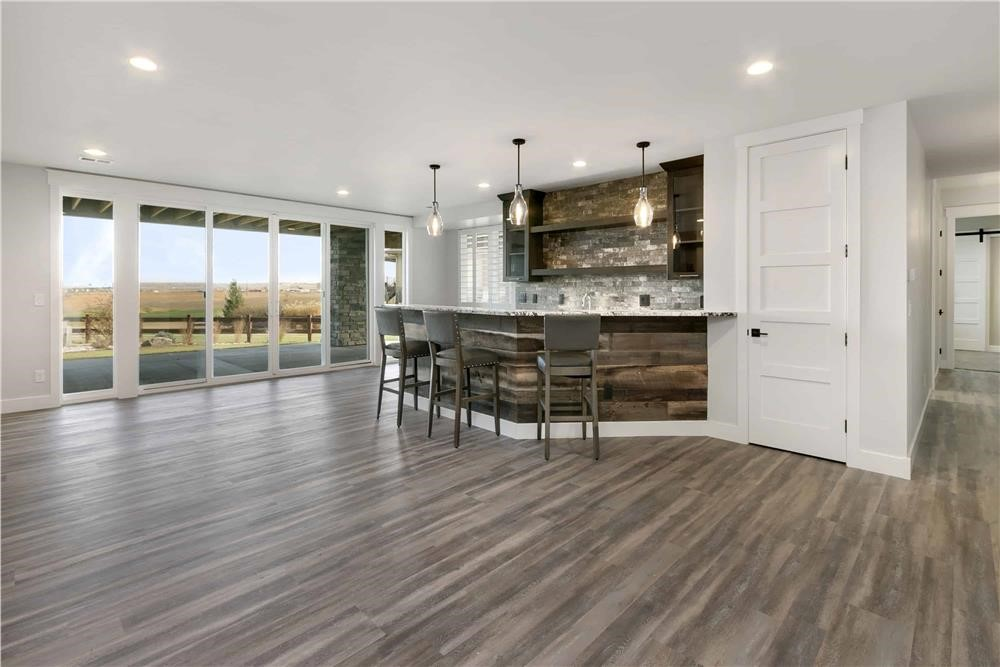 Floor in a Great Room / kitchen with light-dark pattern common with fumed flooring