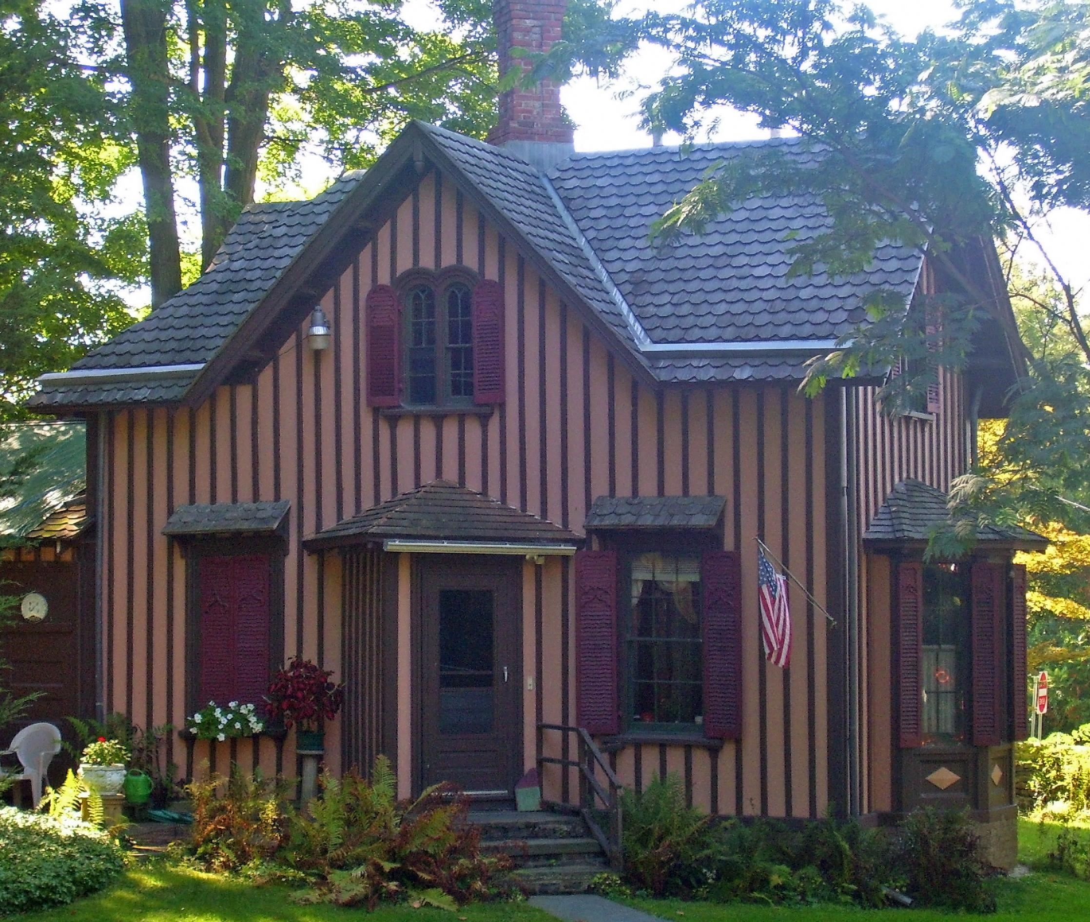 Small house in Carpenter Gothic style with board-and-batten siding