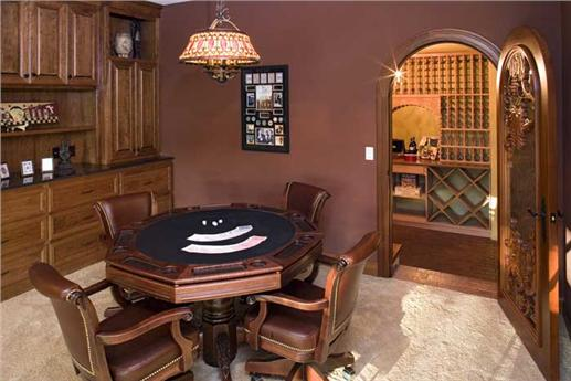 Basement game room that leads to a wine cellar
