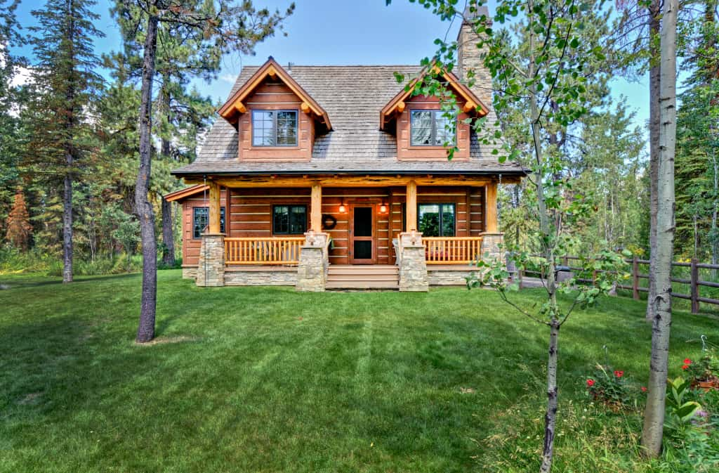 2-story, 2-bedroom log cabin home with covered porch, rear deck, fireplace, and Master Suite