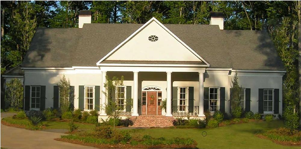 Two-story Country home that has a front porch with its roof supported by four tall columns