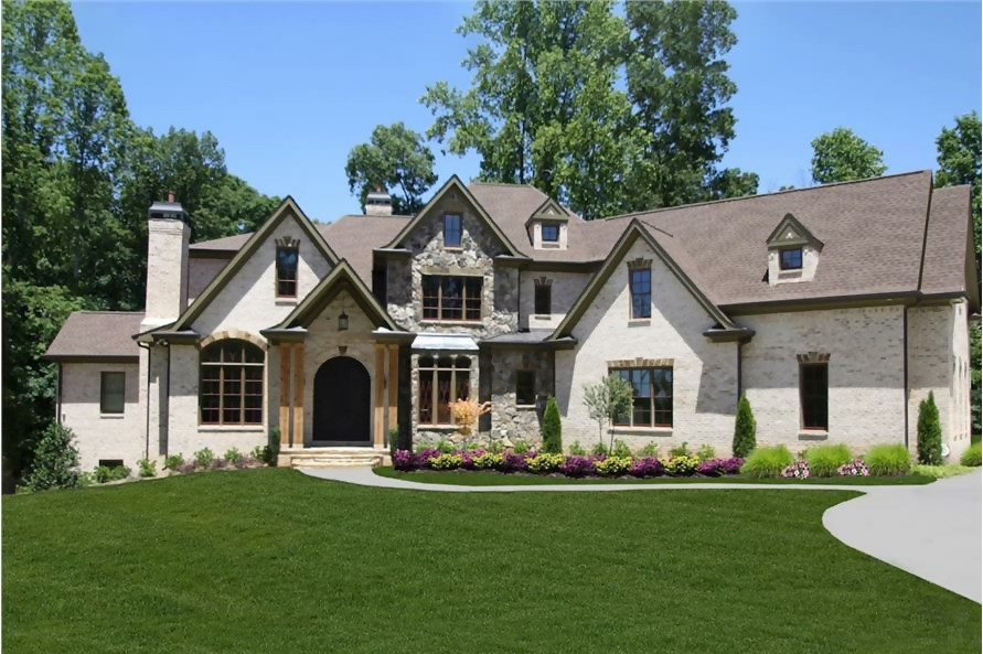 European style home with country manor feel in a mixture of stone and stucco siding