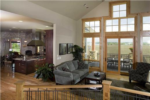 Interior view of family room into kitchen.