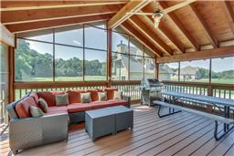 Screened-in covered deck at house plan #161-1003