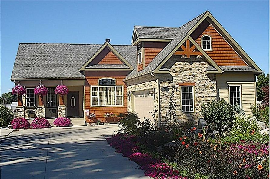 Transitional Craftsman style home with stone and natural shingle siding