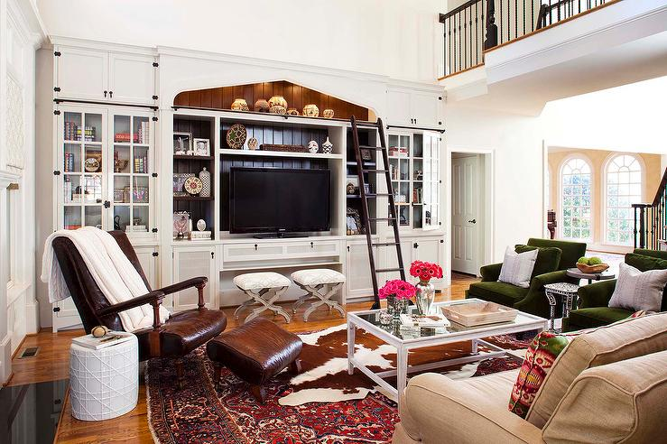 Wonderful white entertainment center with shelving, cabinets, and glass doors