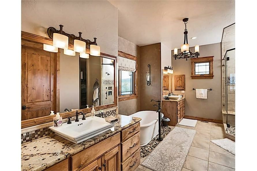 Master bathroom with wood and stone decor accents for a modern rusticated look