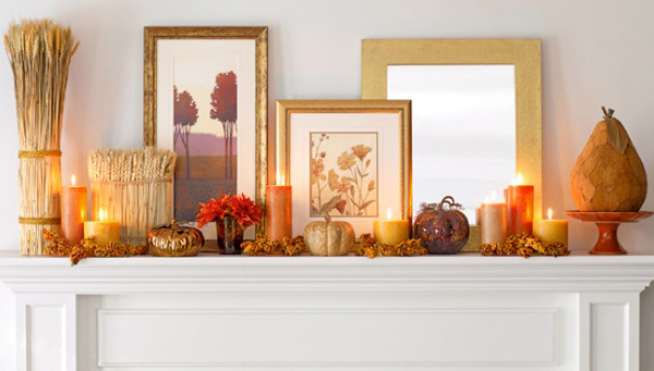 Gathering of fall decor on a beautiful white fireplace mantel