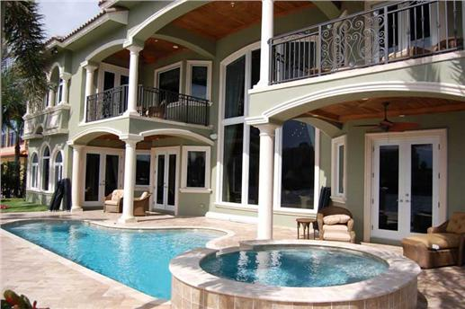 Pool and second-floor balconies define rear of house