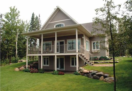 2-story Country-style Cottage home with upper and lower covered reach porches