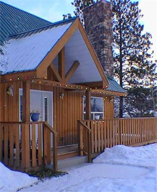 View of entry to A-Frame home with snow