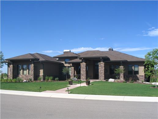 Paririe style home using rock and stone finishes give this home a striking curb appeal.