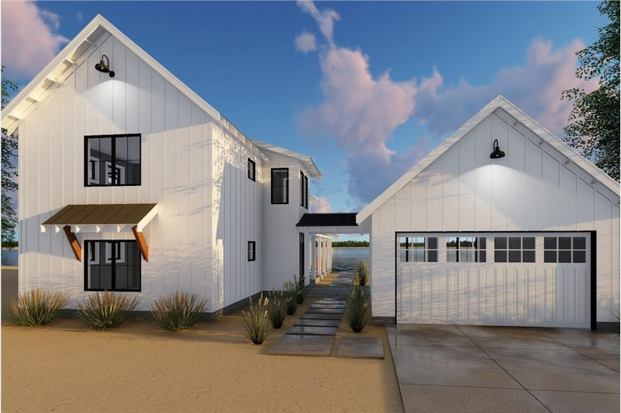 White Farmhouse style home with detached garage connected by a breezeway.