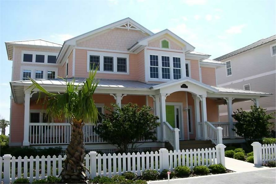 2-story Beachfront style home painted pink with white trim
