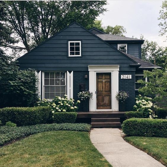 Cottage style home with dark green and gray exterior